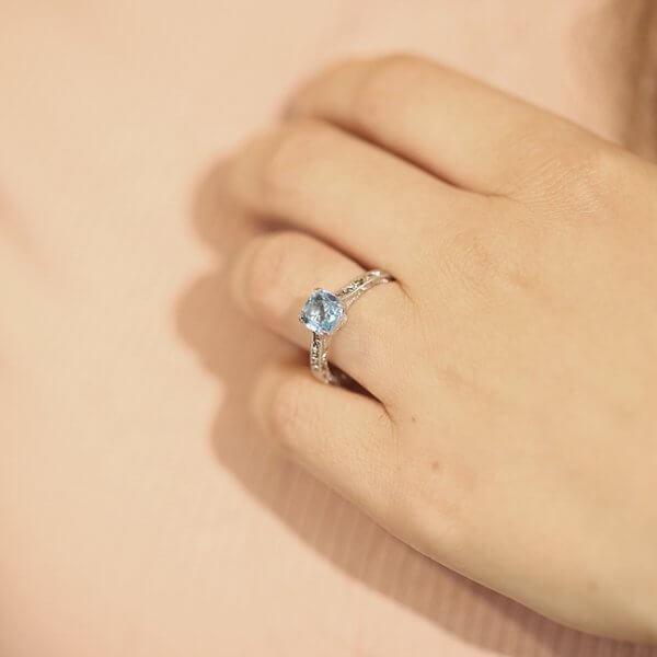 platinum engraved solitaire cushion topaz ring