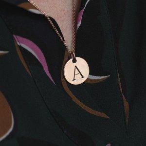 Cut out gold disc letter charm pendant