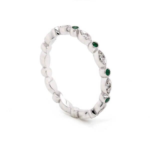 Delicate diamond emerald eternity ring