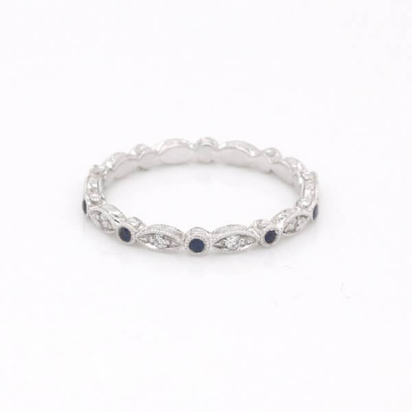 Delicate sapphire and diamond engraved band