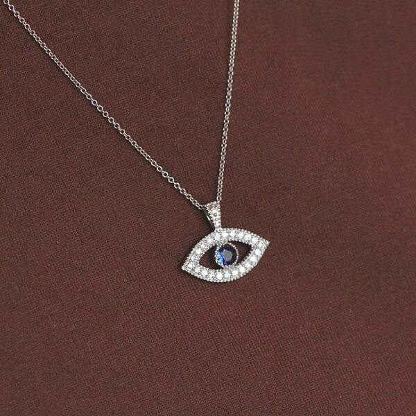 Evil Eye diamond and sapphire protection necklace designed by OroSpot