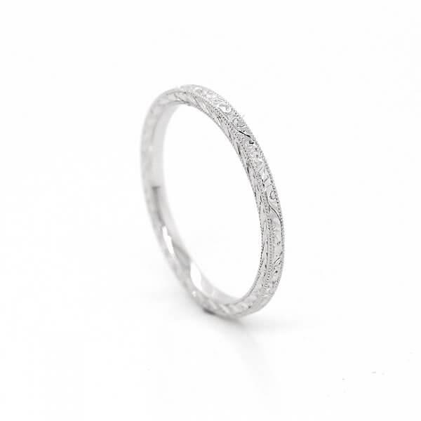 Hand carved skinny wedding ring