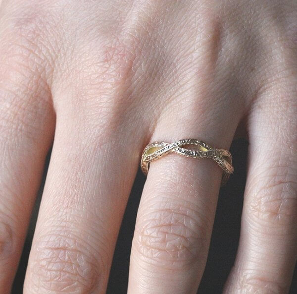 intertwined hand engraved gold wedding ring