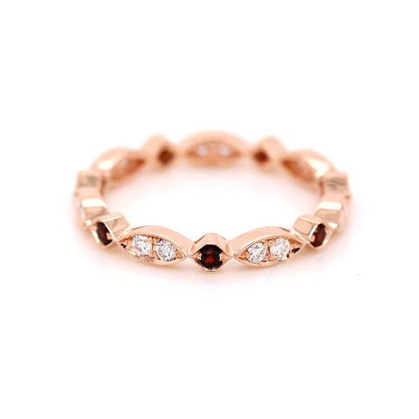 Modern Diamond and garnet eternity ring