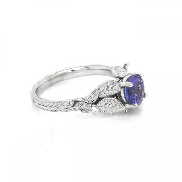 Tanzanite engagement ring with hand engraved leaves in organic design