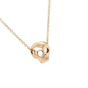 Tiny skull gold charm pendant OroSpot