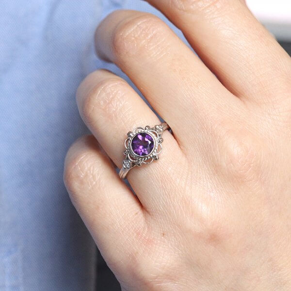 bezel non traditional engagement ring with amethyst and side diamonds OroSpot