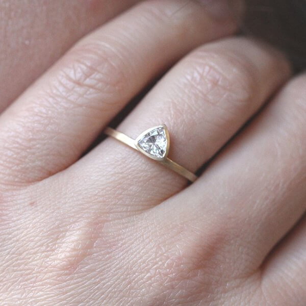 contemporary trillion moissanite engagement ring