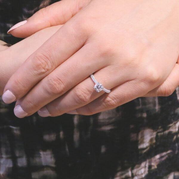 petite diamond engagement ring with round center stone