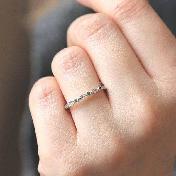 skinny delicate diamonds with geen emeralds stackable band