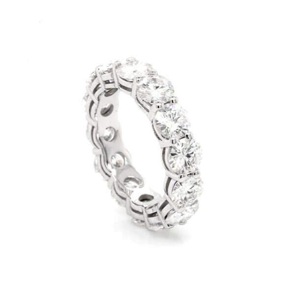 Shared-Prong-Moissanite-eternity-band-in-gold-by-OroSpot