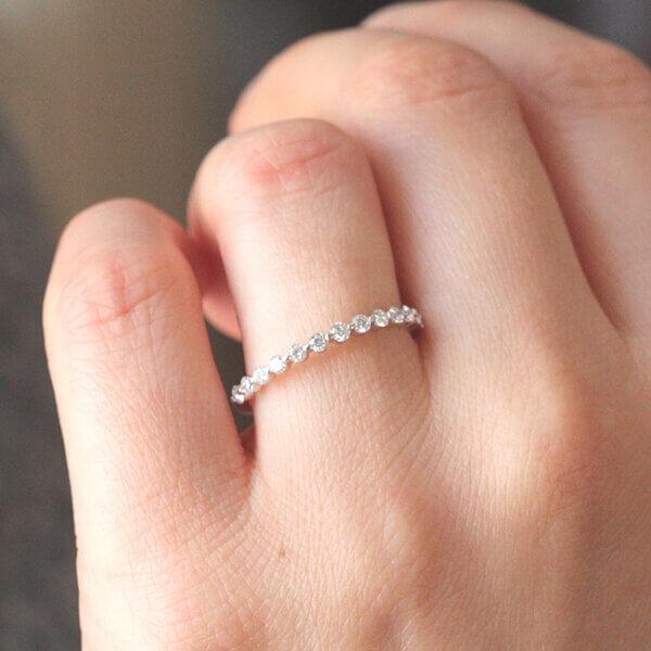 Skinny diamond shared prong band OroSpot