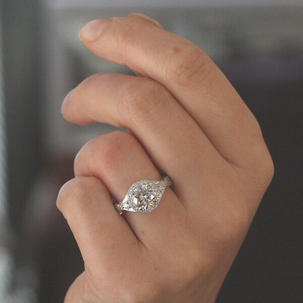 Antique engagement ring with diamonds and Forever One Moissanite by OroSpot