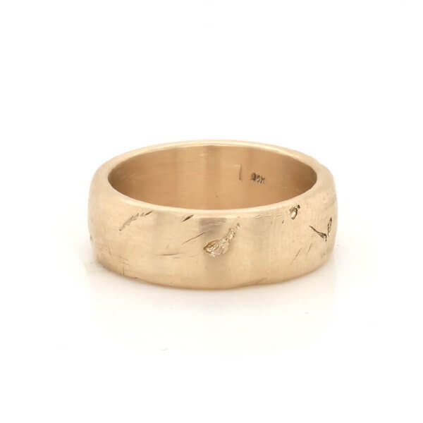 Scratched and worn down designer wedding ring for a guy by OroSpot
