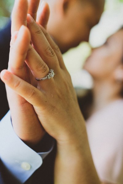 Couple standing close with hands pressed together - Engagement ideas at home