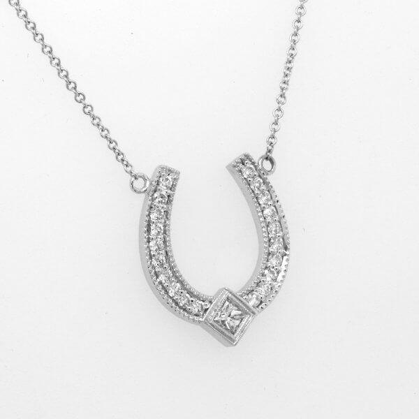 Diamond horseshoe pendant